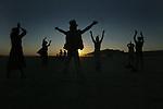 The sunrises over the Black Rock Desert - High Rock Canyon during the Burning Man Festival. .