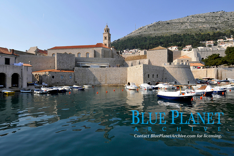 Boats and harbour at the edge of the fort from old historic town, Dubrovnik, Croatia, Adriatic Sea