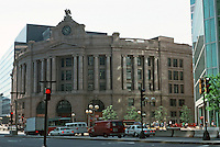 Boston:  South Station by Shepley, Rutan & Coolidge, 1898.  Major renovation completed in 1989.  Neo-Classical Revival style. Eagle on top of building,polished brass gas lights and signage remain.  Photo '88.