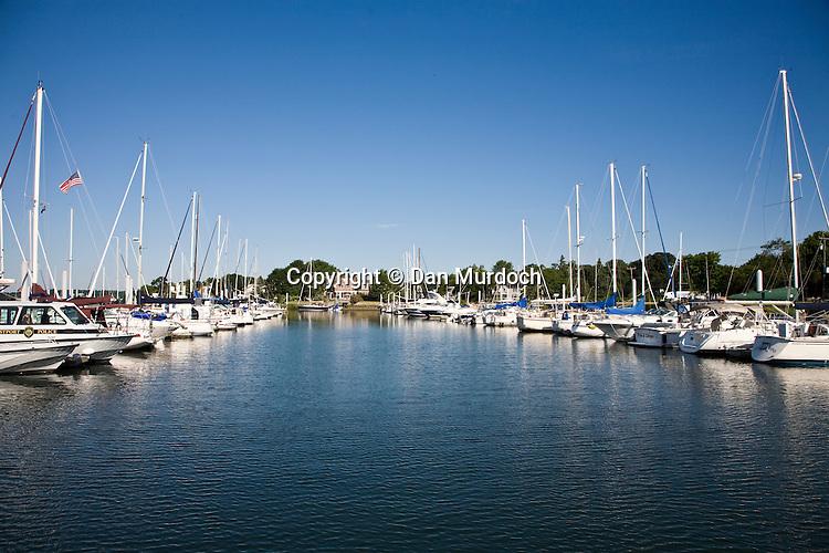 Boats at dock under bright blue skies