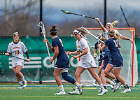 25 April 2015: University of Vermont Catamount Midfielder Vanessa VanderZalm, a Junior from Pelham, Ontario, reaches high to gain possession during game action against the University of New Hampshire Wildcats at Virtue Field in Burlington, Vermont. The Lady Catamounts defeated the Lady Wildcats 12-10 in the final game of the season, advancing to the America East playoffs. Mandatory Credit: Ed Wolfstein Photo *** RAW (NEF) Image File Available ***