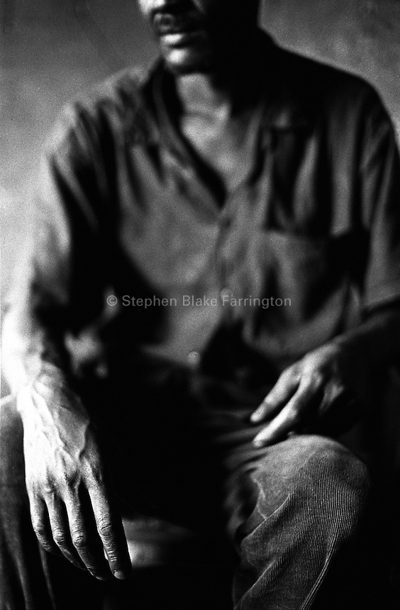 Edinisa, father and caretaker for his siblings? children. His siblings have passed away from AIDS. Mbiko, Uganda<br />