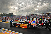 Sept. 30, 2011; Mohnton, PA, USA: NHRA crew members for funny car driver Matt Hagan during qualifying for the Auto Plus Nationals at Maple Grove Raceway. Mandatory Credit: Mark J. Rebilas-