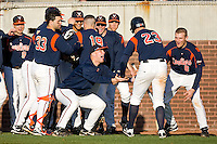 Danny Hultzen #23 of the Virginia Cavaliers is congratulated by his teammates after scoring on a 2-run home run by Steven Proscia #19 (not pictured) against the East Carolina Pirates at Clark-LeClair Stadium on February 19, 2010 in Greenville, North Carolina.   Photo by Brian Westerholt / Four Seam Images
