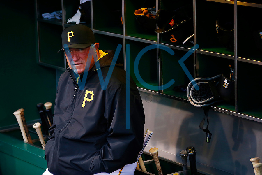 Manager Clint Hurdle #13 of the Pittsburgh Pirates stand-in the dugout against the St. Louis Cardinals during the game at PNC Park in Pittsburgh, Pennsylvania on April 6, 2016. (Photo by Jared Wickerham / DKPS)