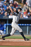 Charleston RiverDogs shortstop Tyler Wade #7 swings at a pitch during a game against the Asheville Tourists at McCormick Field July 26, 2014 in Asheville, North Carolina. The RiverDogs defeated the Tourists 8-7. (Tony Farlow/Four Seam Images)
