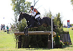 Ingrid Klimke and FRH Butts Abraxxas of Germany compete in the cross country phase of the FEI  World Eventing Championship at the Alltech World Equestrian Games in Lexington, Kentucky.