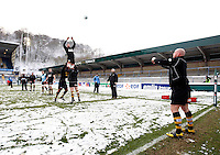 Photo: Richard Lane/Richard Lane Photography.  London Wasps v Newport Gwent Dragons. Heineken Cup. 19/12/2010. Wasps warm up in the snow.