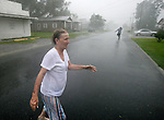 Paula Kyle (L) feels the fury of Hurricane Gustav in Morgan City, Louisiana as it makes landfall September 1, 2008..  (Mark Wallheiser/TallahasseeStock.com)