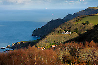 One of the highlights of the North Devon coastline is where Exmoor plunges into the Bristol Channel, a photogenic area of rich colours, high moorland, deep valleys, rocky cliffs and hidden bays. This shot was taken looking eastwards from near Martinhoe, and shows Woody Bay and Crock Point; in the shadows lies Lee Bay, Duty Point with its tower and the Valley of the Rocks. In the distance, across the Bristol Channel, lies the coastline of South Wales.