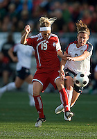25 May 09:  USA National forward Heather O'Reilly #9 and Canadian National midfielder Kelly Parker #19 in action in an International Friendly soccer game between the US Women's Team and the Canadian Women's Team at BMO Field in Toronto..The US Women's Team won 4-0..
