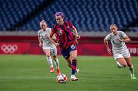 SAITAMA, JAPAN - JULY 24: Megan Rapinoe #15 of the United States on the ball during a game between New Zealand and USWNT at Saitama Stadium on July 24, 2021 in Saitama, Japan.