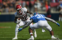 Arkansas running back Trelon Smith (22) carries the ball as Ole Miss defensive back Jaylon Jones (31) blocks, Saturday, October 9, 2021 during the first quarter of a football game at Vaught Hemingway Stadium in Oxford, Miss. Check out nwaonline.com/211010Daily/ for today's photo gallery. <br /> (NWA Democrat-Gazette/Charlie Kaijo)