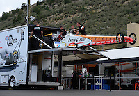 Jul, 22, 2012; Morrison, CO, USA: NHRA crew members for top fuel dragster driver Clay Millican load the car into the hauler during the Mile High Nationals at Bandimere Speedway. Mandatory Credit: Mark J. Rebilas-US PRESSWIRE