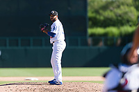 Glendale Desert Dogs relief pitcher Jordan Sheffield (10), of the Los Angeles Dodgers organization, gets ready to deliver a pitch during an Arizona Fall League game against the Mesa Solar Sox at Camelback Ranch on October 15, 2018 in Glendale, Arizona. Mesa defeated Glendale 8-0. (Zachary Lucy/Four Seam Images)