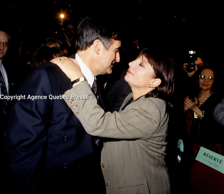 """Montreal (Qc) CANADA - File Photo - Jan 1996 -<br /> <br /> Lucien Bouchard,  Leader Parti Quebecois (from Jan 29, 1996 to March 2, 2001). seen in a file photo with Francine Simard<br /> <br /> After the Yes side lost the 1995 referendum, Parizeau resigned as Quebec premier. Bouchard resigned his seat in Parliament in 1996, and became the leader of the Parti QuÈbÈcois and premier of Quebec.<br /> <br /> On the matter of sovereignty, while in office, he stated that no new referendum would be held, at least for the time being. A main concern of the Bouchard government, considered part of the necessary conditions gagnantes (""""winning conditions"""" for the feasibility of a new referendum on sovereignty), was economic recovery through the achievement of """"zero deficit"""". Long-term Keynesian policies resulting from the """"Quebec model"""", developed by both PQ governments in the past and the previous Liberal government had left a substantial deficit in the provincial budget.<br /> <br /> Bouchard retired from politics in 2001, and was replaced as Quebec premier by Bernard Landry."""