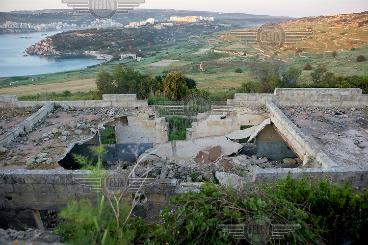 Derelict buildings on a hill top provide a good vantage point across valleys where hunters shoot birds. This building is used by volunteers with Spring Watch Malta to check on migrating birds and look out  for illegal hunters.Under EU leglislation, hunting or trapping birds in spring is illegal but the government of Malta, which joined the EU in 2004, allows hunting of turtle dove and quail at this time of year. Some 170 species of bird pass over Malta during the spring and autumn migration periods. Hunters regularly shoot other species including birds of prey which are stuffed for private collection. Spring Watch Malta is a conservation camp run by BirdLife Malta, a non-profit which lobbies against bird hunting in the country. In 2012, fifty volunteers from across Europe converged on a tourist hotel in Bugibba in northern Malta and fanned out to track migrating birds and monitor any illegal spring hunting by the 11,000 permitted hunters........