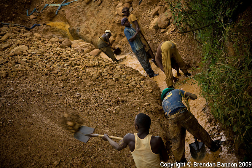Miners at work near Makala shaft mine. The  men identify abandoned mines and  sift  for residual gold left in the earth in Eastern Democratic Republic of Congo.
