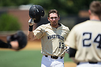 Keegan Maronpot (13) of the Wake Forest Demon Deacons approaches home plate after hitting a grand slam home run on the bottom of the fifth inning against the Pittsburgh Panthers at David F. Couch Ballpark on May 20, 2017 in  Winston-Salem, North Carolina.  (Brian Westerholt/Four Seam Images)