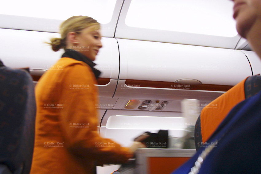 France. Flight to Nice. Flight attendant and service on board the low cost company EasyJet. EasyJet Airline Company Limited (styled as easyJet) is a British airline headquartered and the largest airline of the United Kingdom, measured by number of passengers carried, operating domestic and international scheduled services on over 500 route© 2004 Didier Ruef