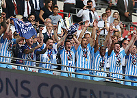 28th May 2018, Wembley Stadium, London, England;  EFL League 2 football, playoff final, Coventry City versus Exeter City; Michael Doyle of Coventry City lifts the EFL League 2 trophy alongside his players from the gantry