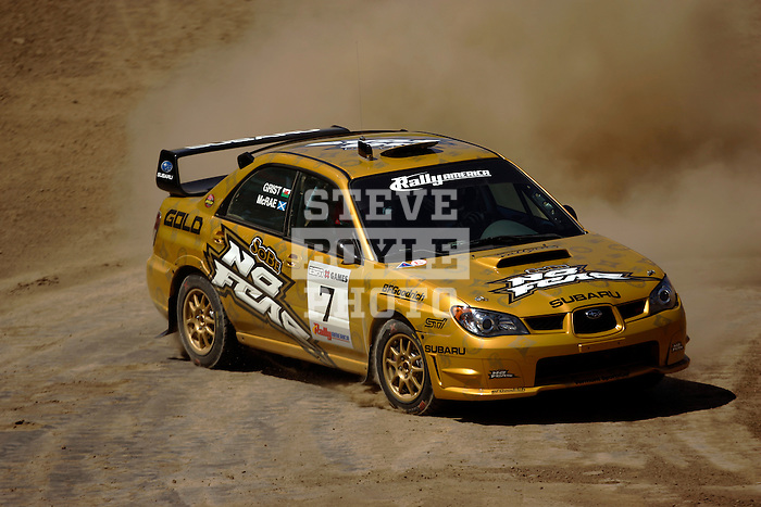 Driver Colin McRae and co-driver Nicky Grist come around a turn near the finish line while competing in the Rally Car Race finals during X-Games 12 in Los Angeles, California on August 5, 2006.