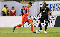 CHICAGO, ILLINOIS - JULY 07: Christian Pulisic #10 during the 2019 CONCACAF Gold Cup Final match between the United States and Mexico at Soldier Field on July 07, 2019 in Chicago, Illinois.