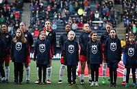 Seattle, WA - Saturday March 24, 2018: Washington Spirit, escort kids during a regular season National Women's Soccer League (NWSL) match between the Seattle Reign FC and the Washington Spirit at the UW Medicine Pitch at Memorial Stadium.