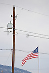 American flag and utility pole and wires.