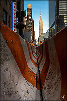 Empire State Building with concrete traffic barriers.