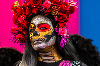 A young Mexican woman, dressed as La Catrina, a Mexican pop culture icon representing the Death, takes part in the Day of the Dead festivities in Oaxaca, Mexico, 31 October 2019. Day of the Dead (Día de Muertos), a religious holiday combining the death veneration rituals of Pre-Hispanic cultures with the Catholic practice, is widely celebrated throughout all of Mexico. Based on the belief that the souls of the departed may come back to this world on that day, people gather together while either praying or joyfully eating, drinking, and playing music, to remember friends or family members who have died and to support their souls on the spiritual journey.