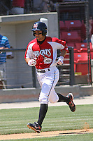 Jake Kahaulelio #3 of the Carolina Mudcats scoring during a game against the Chattanooga Lookouts on on May 9, 2010 in Zebulon, NC.