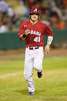 Brock Bennett #41 of the Alabama Crimson Tide scores a run in the first inning against the Auburn Tigers at Riverwalk Park on March 15, 2011 in Montgomery, Alabama.  Photo by Brian Westerholt / Four Seam Images