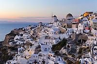 Greece. Evening lights of Oia on Santorini island.