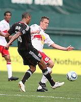 Jordan Graye #16 of D.C. United knocks the ball away from Seth Stammler #6 of the New York Red Bulls during an MLS match on May 1 2010, at RFK Stadium in Washington D.C.