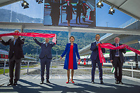 "Switzerland. Canton Ticino. Camorino. Ceneri Base Tunnel (CBT). Official opening ceremony. (Left to right) Dieter Schwank (CEO Alptransit Gaothard AG), Federal Councillor Ignazio Cassis, Swiss President Simonetta Sommaruga, Norman Gobbi (Ticino State Councilor), Vincent Ducrot (CEO CFF FFS SBB). Swiss President Simonetta Sommaruga cuts the red ribbon. The Ceneri Base Tunnel (CBT) (Italian: Galleria di base del Monte Ceneri) is a railway base tunnel in Canton Ticino. It passes under Monte Ceneri between Camorino in the Magadino Flat and Vezia near Lugano, and bypasses the former high-altitude rail route through the Monte Ceneri Tunnel. It is composed of two single-track tunnels, each 15.4 km long. It is another part of the New Railway Link through the Alps (NRLA) project. The impact will be significant on international traffic with shorter time trips. The opening of the Ceneri tunnel also means a transport revolution for the southern canton of Ticino. Regional rail lines will be upgraded, and some reckon the change could lead to the creation of a ""Ticino City"" – one big urban sprawl across the canton. 4.09.2020  © 2020 Didier Ruef"