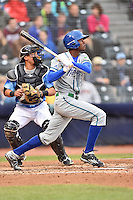 Hartford Yard Goats right fielder Raimel Tapia (15) swings at  pitch during a game against the Richmond Flying Squirrels at The Diamond on April 30, 2016 in Richmond, Virginia. The Yard Goats defeated the Flying Squirrels 5-1. (Tony Farlow/Four Seam Images)