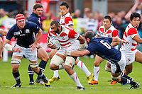 Japan Flanker Michael Leitch is tackled by Scotland Flanker Ryan Wilson - Mandatory byline: Rogan Thomson - 23/09/2015 - RUGBY UNION - Kingsholm Stadium - Gloucester, England - Scotland v Japan - Rugby World Cup 2015 Pool B.