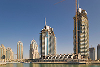 Dubai.  Apartment tower blocks and boats at Dubai Marina...
