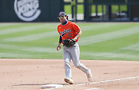 Arkansas infielder Matt Goodheart (10) makes a catch, Saturday, April 3, 2021 during the fourth inning of a baseball game at Baum-Walker Stadium in Fayetteville. Check out nwaonline.com/210404Daily/ for today's photo gallery. <br /> (NWA Democrat-Gazette/Charlie Kaijo)