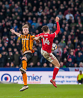 Hull City's midfielder Max Clark (24) jumps with Nottingham Forest's midfielder Matty Cash (14) during the FA Cup 4th round match between Hull City and Nottingham Forest at the KC Stadium, Kingston upon Hull, England on 27 January 2018. Photo by Stephen Buckley / PRiME Media Images.