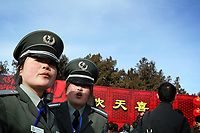 CHINA. Security guards during Chinese New Year in Ditan Park in Beijing.  Chinese New Year, or Spring Festival, is the most important festival and holiday in the Chinese calendar In mainland China, many people use this holiday to visit family and friends and also visit local temples to offer prayers to their ancestors. The roots of Chinese New Year lie in combined influences from Buddhism, Taoism, Confucianism, and folk religions.  2008
