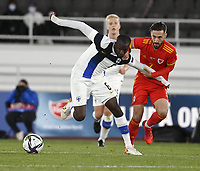 September 1st 2021: Helsinki, Finland;  Finlands Glen Kamara and Joshua Sheehan of Wales fight for the ball during the International Friendly, Finland versus Wales at the Helsinki Olympic Stadium