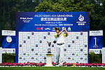 Daxing Jin of China tees off during the 2011 Faldo Series Asia Grand Final on the Faldo Course at Mission Hills Golf Club in Shenzhen, China. Photo by Victor Fraile / Faldo Series