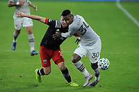WASHINGTON, DC - NOVEMBER 8: Romell Quioto #30 of Montreal Impact battles for the ball with Russell Canouse #4 of D.C. United during a game between Montreal Impact and D.C. United at Audi Field on November 8, 2020 in Washington, DC.