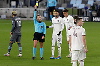 ST PAUL, MN - OCTOBER 28: Referee Tori Penso gives a yellow card during a game between Colorado Rapids and Minnesota United FC at Allianz Field on October 28, 2020 in St Paul, Minnesota.