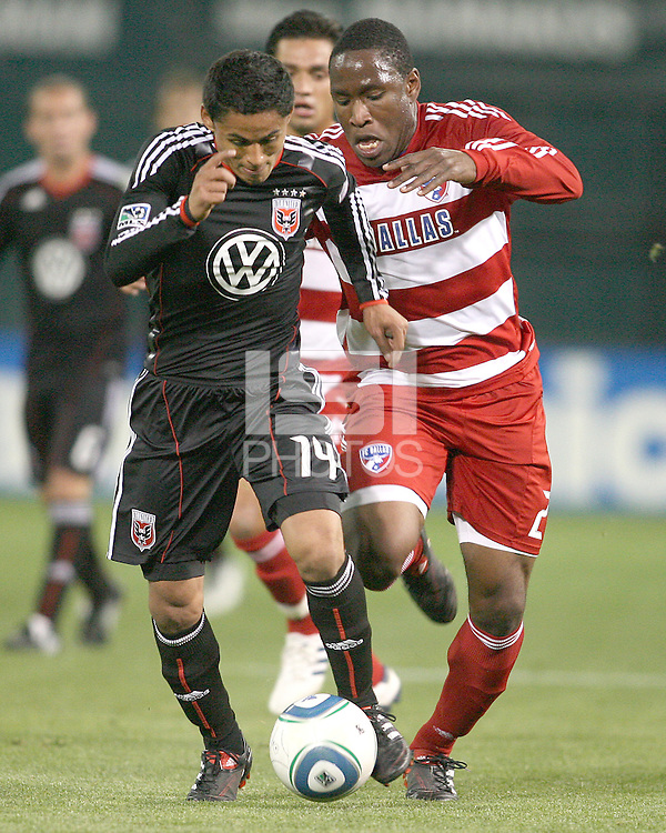 Andy Najar #14 of D.C. United about to be tackled by Edson Edwards #27 of F.C. Dallas during a US Open Cup match on April 28 2010, at RFK Stadium in Washington D.C. United won 4-2.
