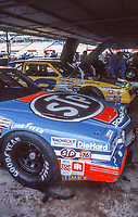 HAMPTON, GA - NOV 3:  Richard Petty's STP Pontiac and Dale Earnhardt's #3 Wrangler Chevrolet are shown in the garage before the Atlanta Journal 500 NASCAR Winston Cup race at Atlanta Motor Speedway, November 3, 1985. (Photo by Brian Cleary/www.bcpix.com)