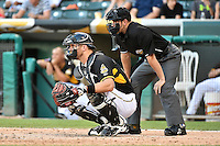 John Hester (22) of the Salt Lake Bees behind the plate with home plate umpire Adam Schwarz during the game against the Reno Aces in Pacific Coast League action at Smith's Ballpark on July 23, 2014 in Salt Lake City, Utah.  (Stephen Smith/Four Seam Images)