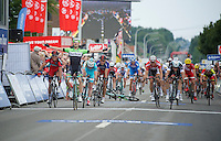 stage winner Paul Martens (DEU/Belkin) celebrates his stage victory while his teammate Sep Vanmarcke (BEL/Belkin) crashes just in front of the finishline behind him<br /> <br /> 2014 Belgium Tour<br /> (final) stage 5: Oreye - Oreye (179km)